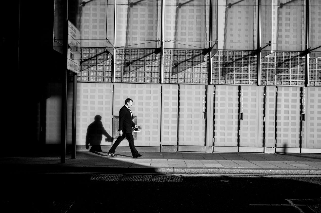 Shadow and Light. Rawstreets Stranger Black And White Photography Monochrome Photography Streetlife Prime Lens Maxgor.com Maxgor City Life London Street Photography Candid People Streetphotography The City Light Light And Shadow Light And Dark Shadow Canary Wharf