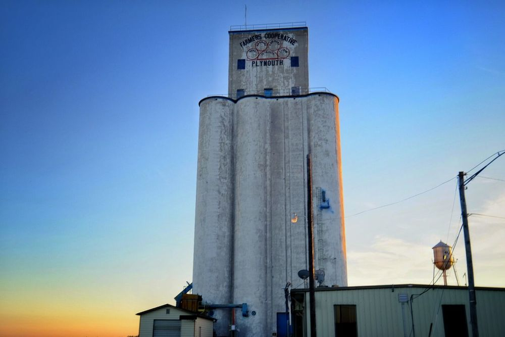 Farmers cooperative Plymouth, Nebraska October 2015 Agriculture Blue Sky Building Building Exterior Built Structure Clear Sky Corn Dusk Exterior Farm Life Farmers Grain Elevator Industry Look Up Low Angle View MidWest Nebraska Old Buildings Plymouth Rural America Skyline Small Town Sunset Tall - High Tower