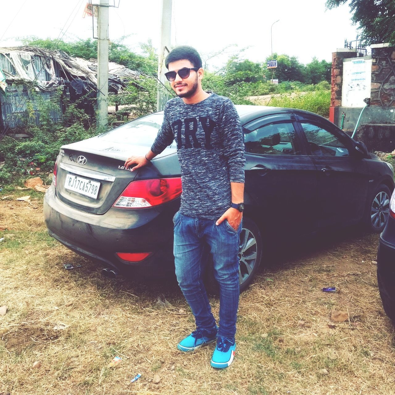 sunglasses, car, young adult, real people, one person, full length, casual clothing, transportation, standing, young men, day, outdoors, lifestyles, tree, young women, people