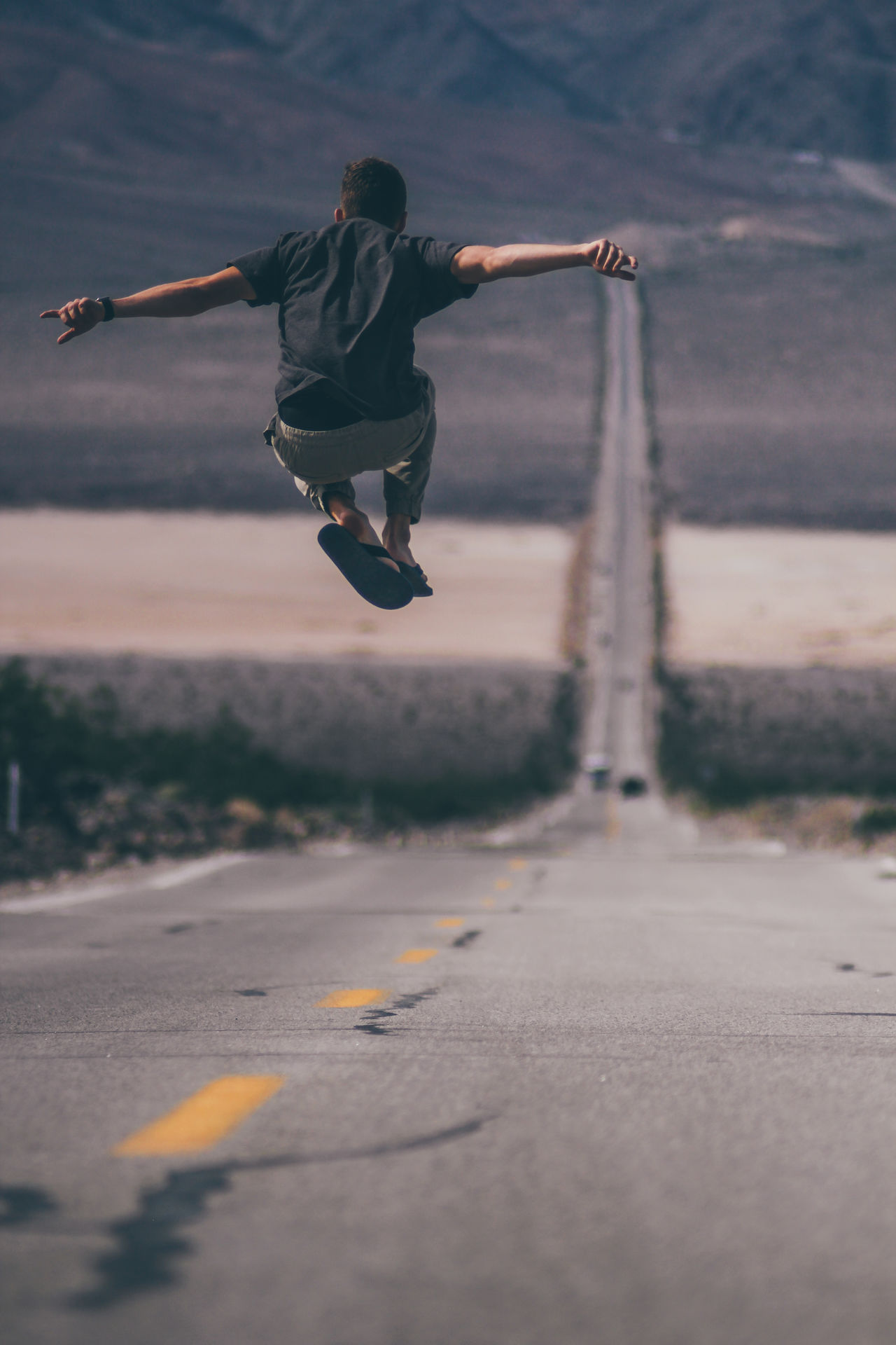 Adult Arizona California Day Death Valley Death Valley National Park Death Valley, California Full Length Human Body Part Jump Jumping Las Vegas Men Mid-air Motion One Man Only One Person Only Men Outdoors People Road Roadtrip Skill  Sky Young Adult