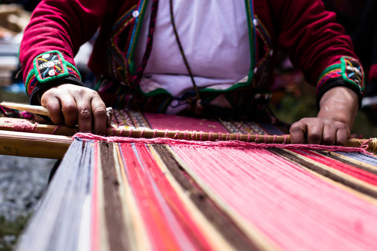 Peruvian woman weaving multi-colored alpaca wool, using ancient techniques, Sacred Valley, Peru. First Eyeem Photo