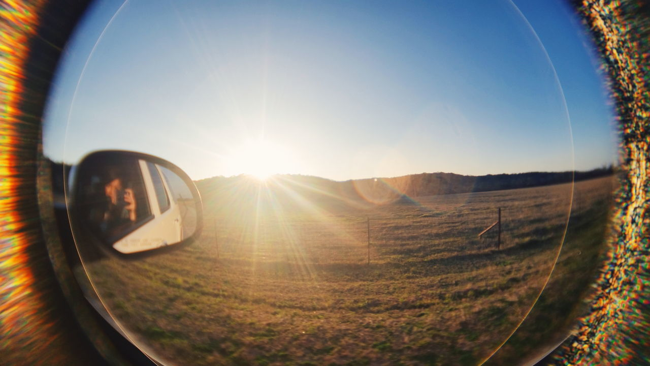 lens flare, sun, sunlight, sunbeam, fish-eye lens, side-view mirror, reflection, no people, sky, landscape, outdoors, day, nature, beauty in nature, photography themes, scenics, camera - photographic equipment, close-up