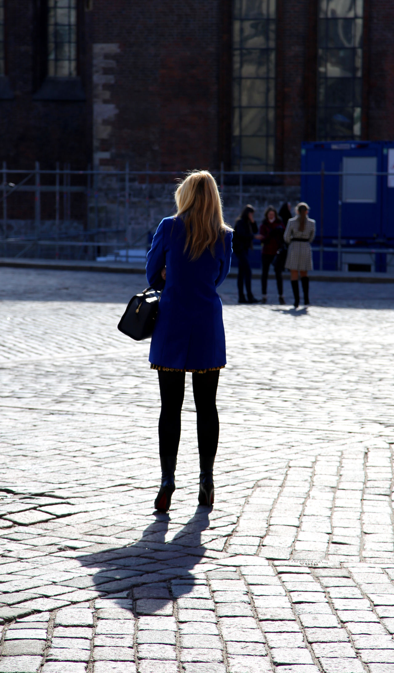 elegant blonde lady in Riga on a market square in high heels and short dress talking on the phone Blonde Woman Casual Clothing City City Life Day Elegant Woman Footpath Full Length Latvian Woman Leisure Activity Lifestyles Outdoors Rendezvous Waiting For The Date Elegance And Class Elegant Elegance Beauty Elegant Way Of Standing Elegant Woman Lady