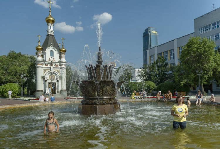 Russia, Yekaterinburg, fountains, heat, youth Architecture Built Structure Capital Cities  City Day Leisure Activity Lifestyles Outdoors Russia, Yekaterinburg, Fountains, Heat, Youth Sky Tourism Travel Destinations Tree Water