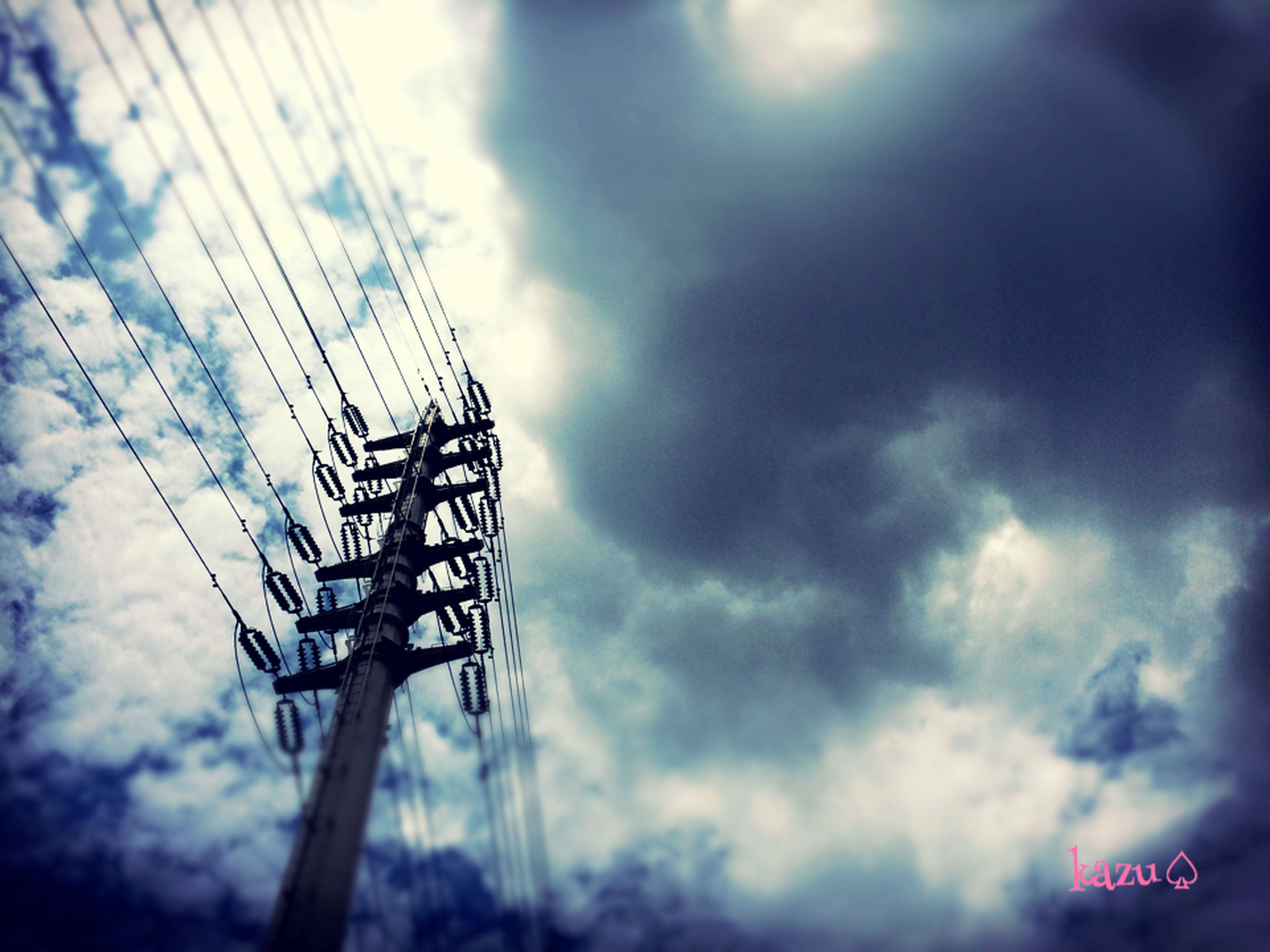 low angle view, sky, cloud - sky, cloudy, communication, power line, electricity, electricity pylon, cable, text, power supply, connection, cloud, western script, pole, no people, technology, weather, street light, lighting equipment