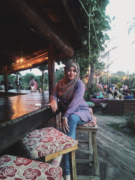 Live For The Story Only Women Smiling One Person Adult Sitting Adults Only People Portrait One Woman Only Looking At Camera Full Length Enjoyment Lifestyles Outdoors Day Indonesian