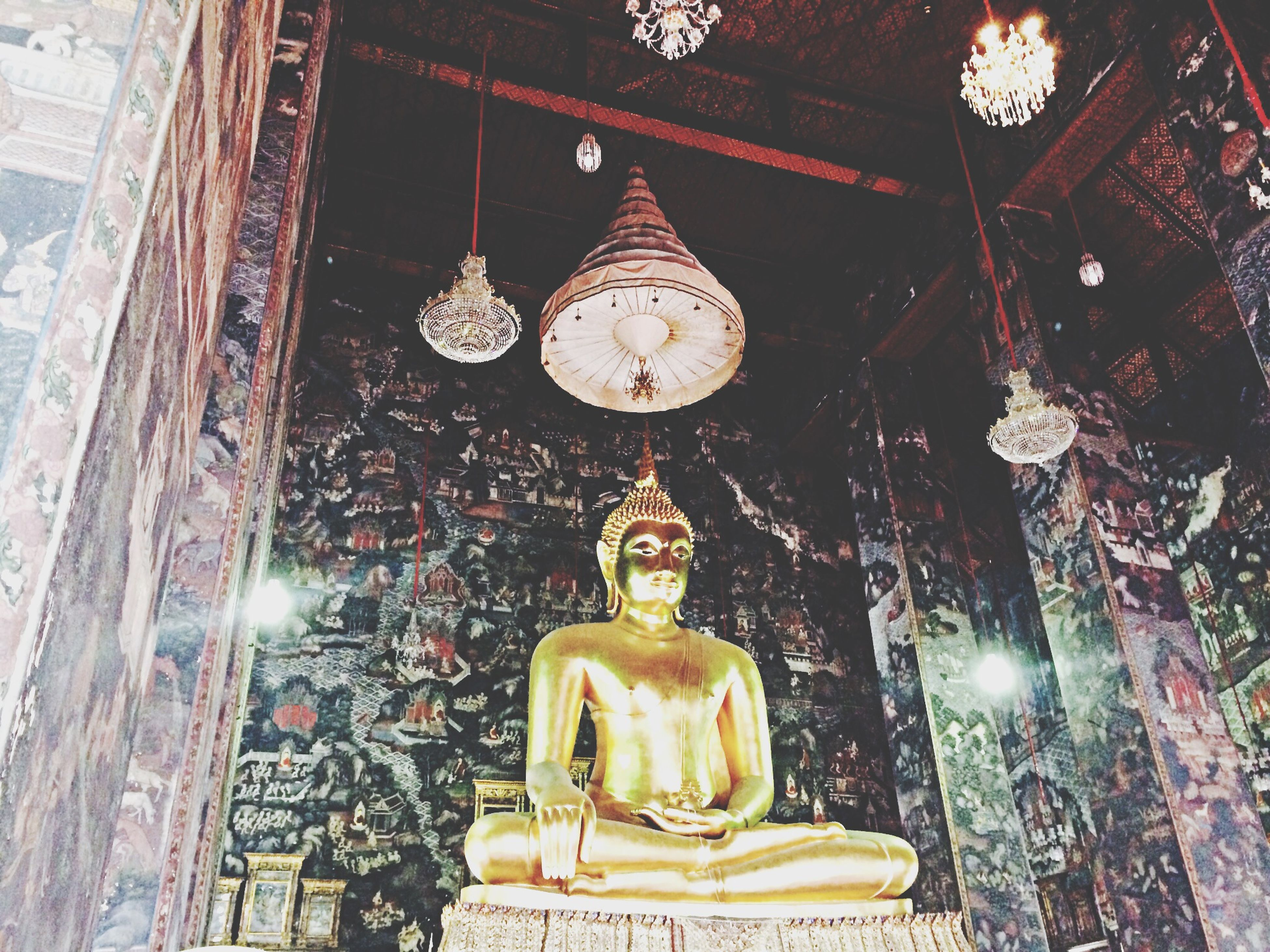 religion, spirituality, human representation, place of worship, art and craft, statue, art, sculpture, creativity, indoors, low angle view, temple - building, buddha, illuminated, church