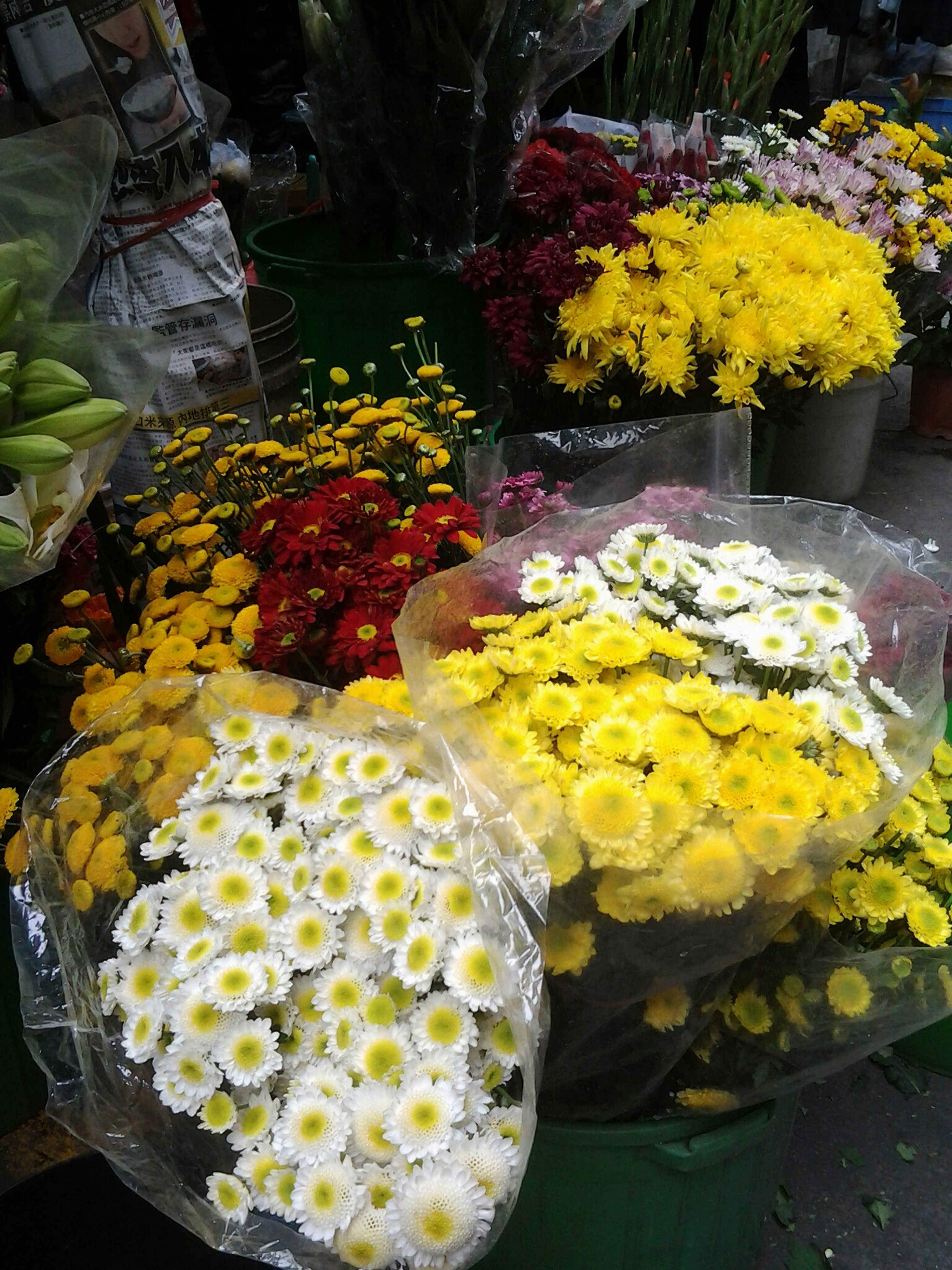 freshness, flower, yellow, fragility, indoors, food and drink, high angle view, variation, petal, food, plant, beauty in nature, nature, growth, healthy eating, vase, table, flower head, no people, close-up