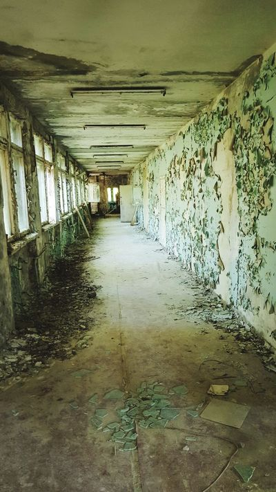 Run down hallway in Pripyat, Chernobyl exclusion zone Ghost Town Abandoned Lost Places Lost Place Eyem Best Shots EyEmNewHere Soviet Ukraine Chernobyl Pripryat Nuclear Hallway Ruin Old Chernobyl Exclusion Zone Eerie Eerie Beautiful Run Down Broken Green
