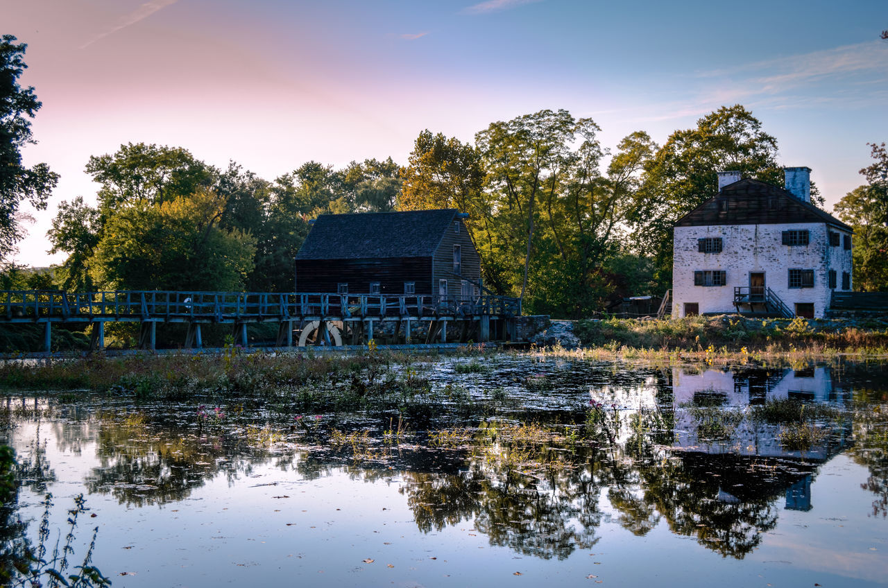 built structure, architecture, water, tree, reflection, no people, outdoors, building exterior, waterfront, sky, lake, day, nature