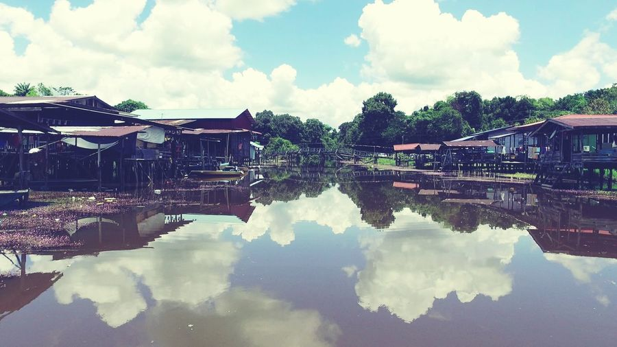Malaysia Truly Asia River House cloud - sky Reflection Water Sky Outdoors Architecture Day Building Exterior No People Nature House Village River Houses