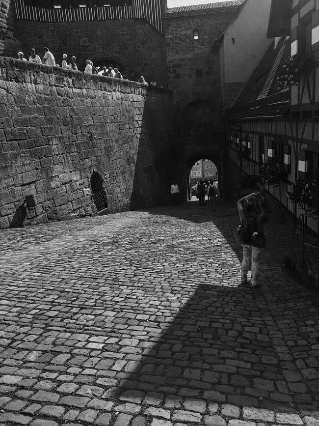 Architecture Black And White Building Exterior Built Structure Day Footpath Full Length Germany Innocence Nürnberg Outdoors Paving Stone Pedestrian Walkway Shadow The Way Forward Walking
