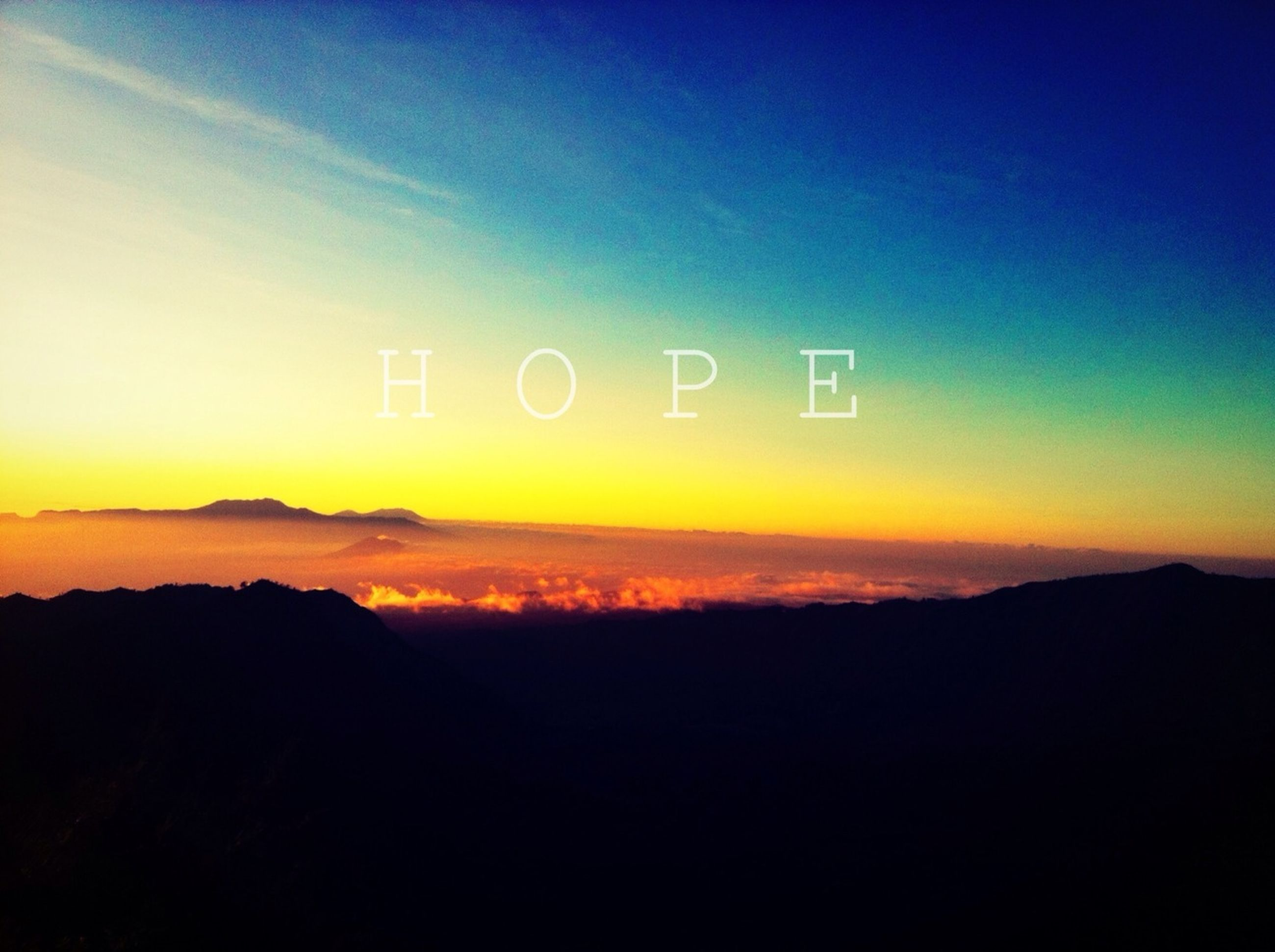 sunset, silhouette, scenics, beauty in nature, tranquil scene, tranquility, copy space, sky, mountain, text, nature, communication, idyllic, western script, orange color, dusk, landscape, outdoors, no people, dark