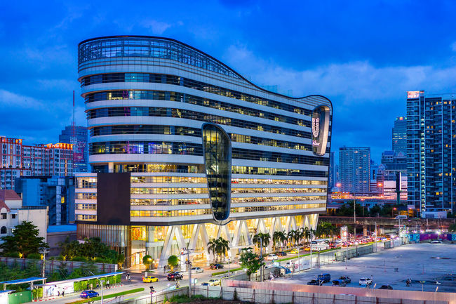Bangkok, Thailand - July 1, 2016: Unilever House Building (Unilever Thailand) on Rama 9 Road in Twilight Time. Architecture Blue Building Exterior Building Story Built Structure City City Life Development Financial District  Modern No People Office Building Outdoors Sky Skyscraper Street Tall Tall - High Transportation