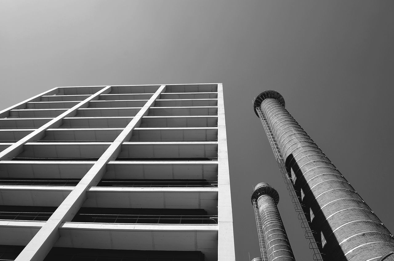 Architecture Low Angle View Building Exterior Built Structure No People Clear Sky Modern Skyscraper City Outdoors Day Sky Street Photography EyeEm Gallery Low Angle View Perspective From My Point Of View Blackandwhite Photography EyeEm Bnw Industrial Landscapes Power Lines Blackandwhite