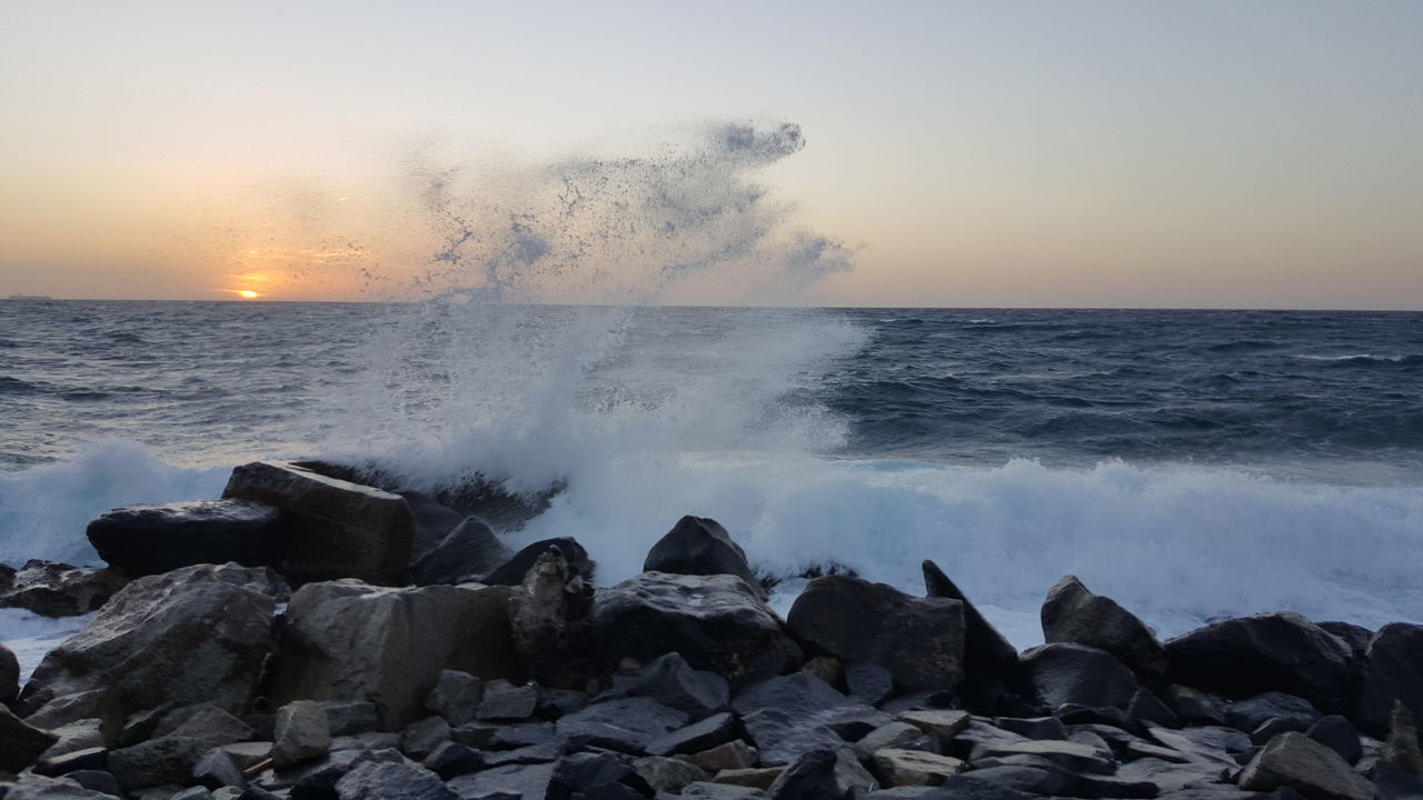 Beach Beauty In Nature Breaking Crash Hitting Horizon Over Water Live For The Story Motion Nature No People Outdoors Power In Nature Rock - Object Sea Sky Sunset Water Wave First Eyeem Photo