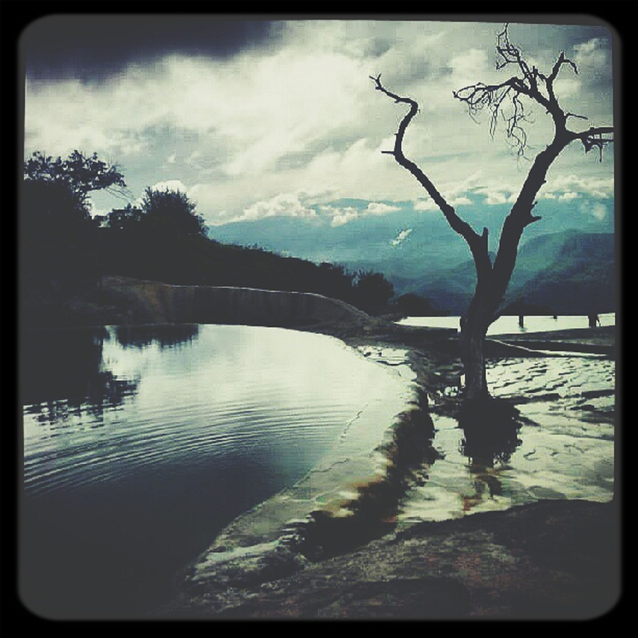 transfer print, water, sky, auto post production filter, tree, cloud - sky, tranquil scene, tranquility, lake, scenics, beauty in nature, mountain, nature, cloud, river, cloudy, reflection, silhouette, waterfront, bare tree