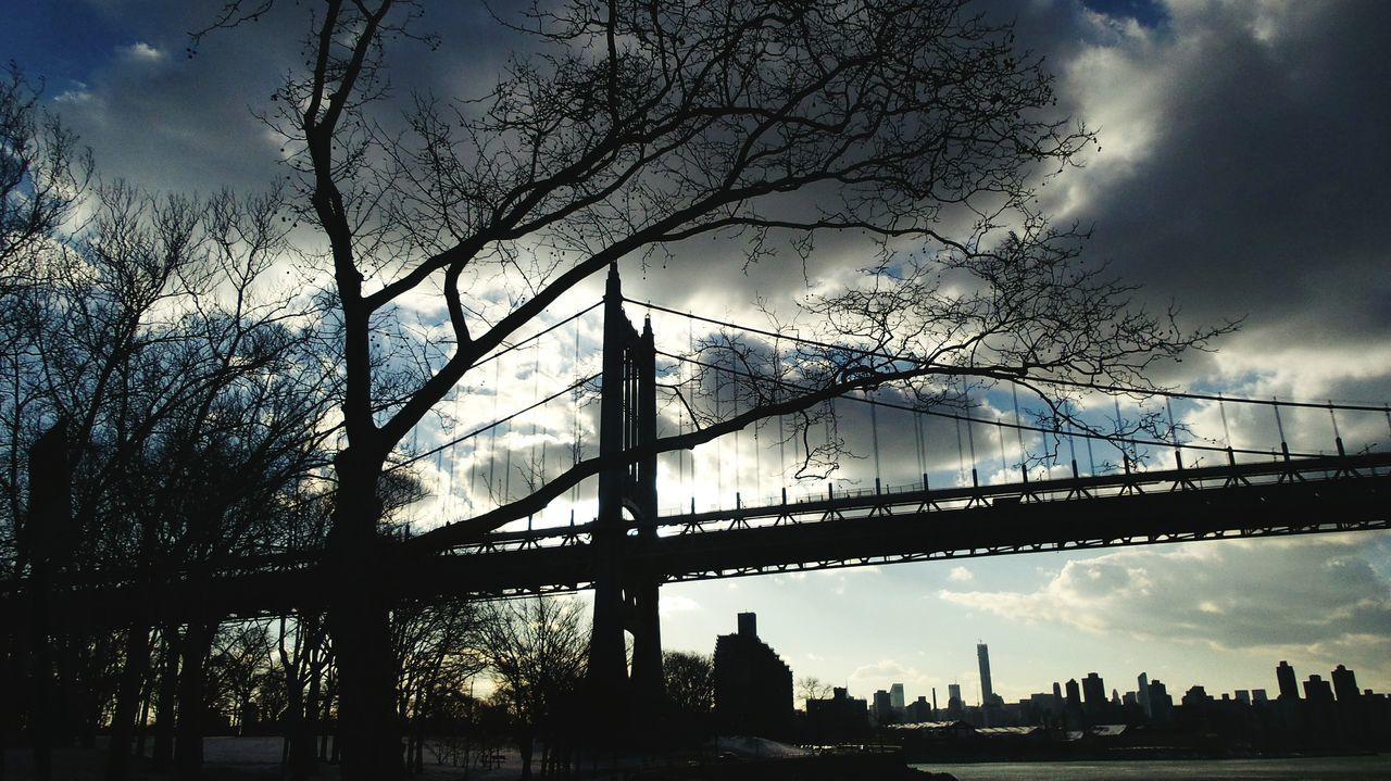 Low Angle View Of Silhouette Triborough Bridge Against Sky At Dusk