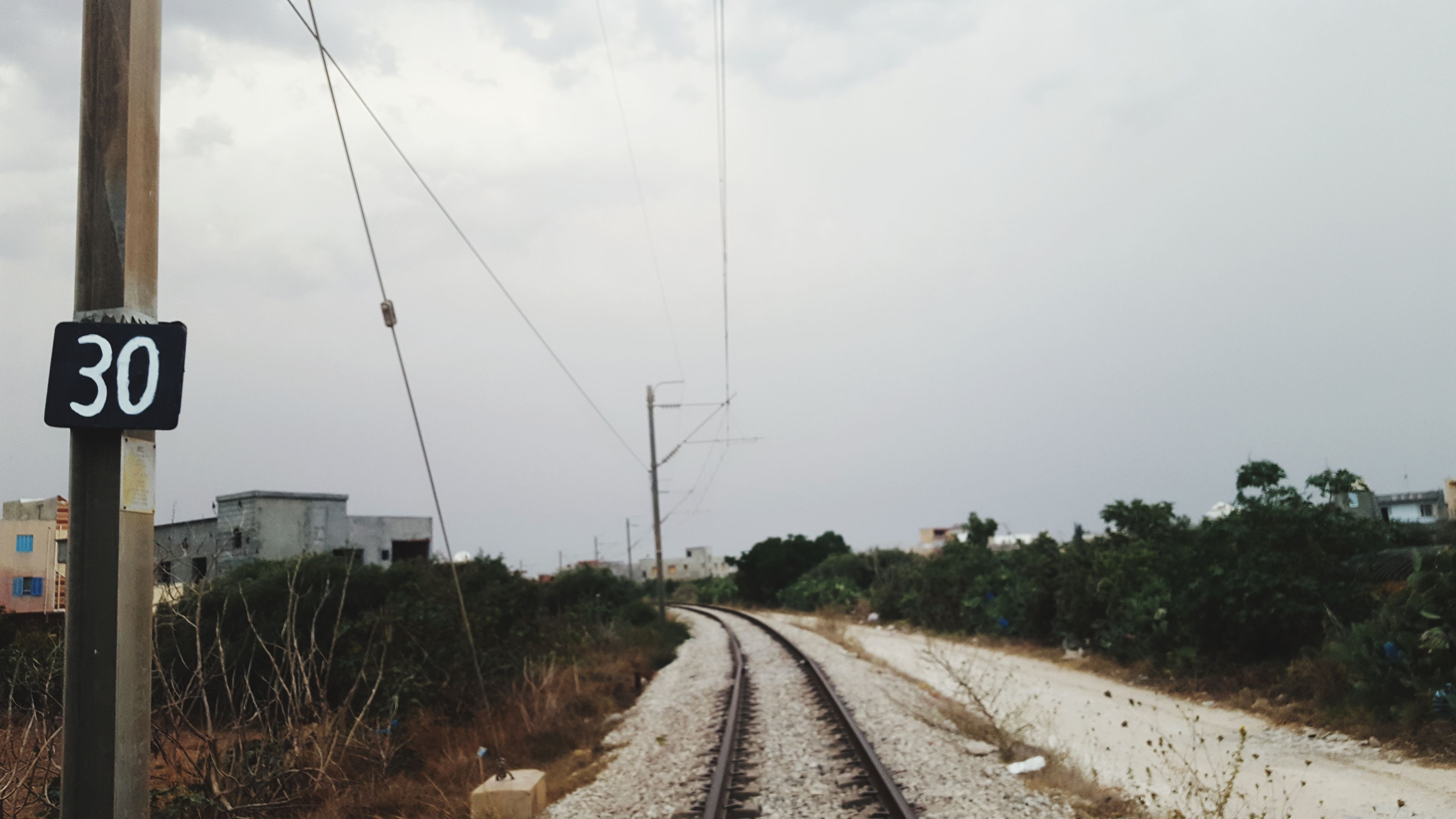 railroad track, transportation, rail transportation, sky, day, tree, cloud - sky, the way forward, electricity pylon, no people, outdoors, cable, nature