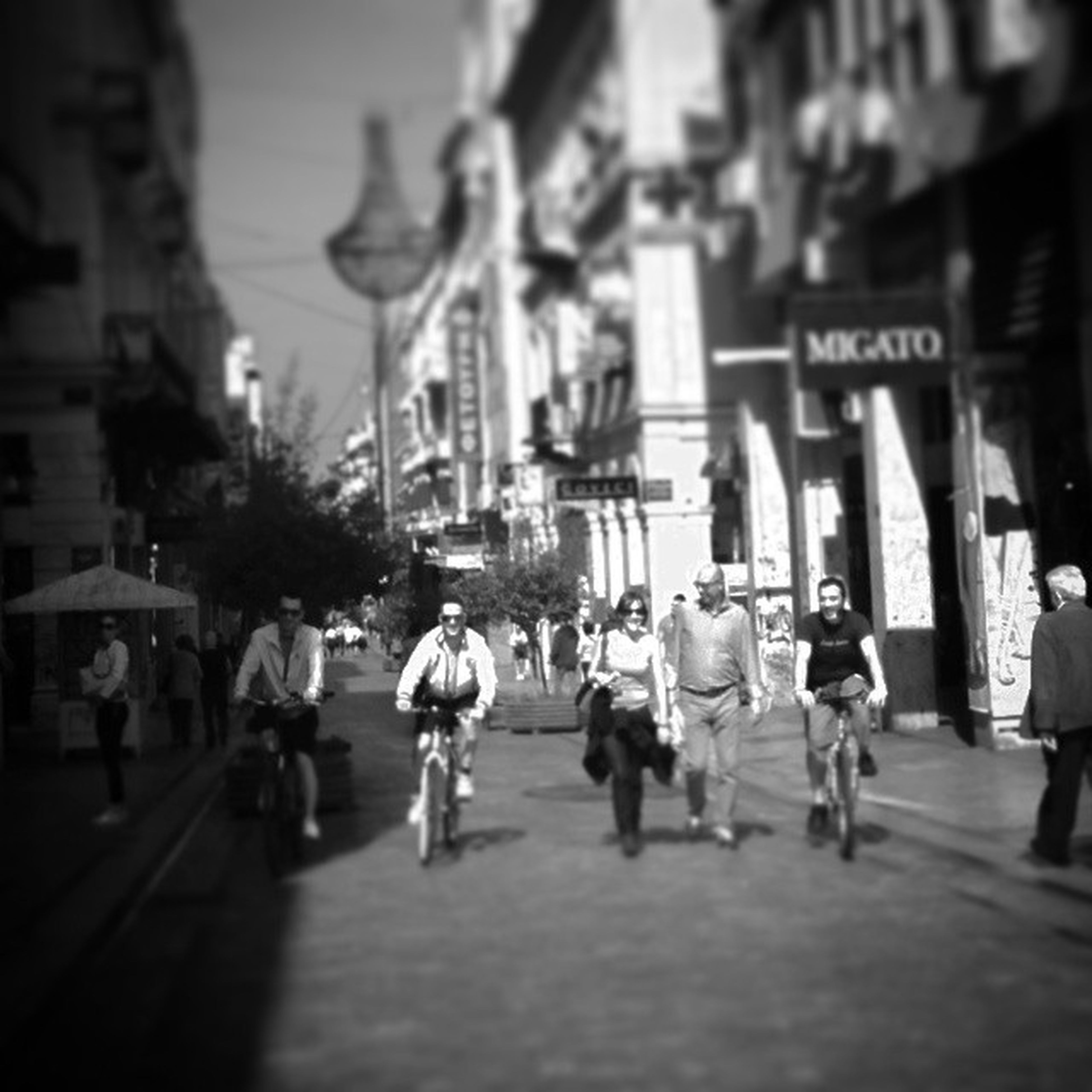 walking, street, building exterior, architecture, men, city, built structure, person, city life, large group of people, the way forward, lifestyles, road, transportation, on the move, city street, full length, leisure activity, group of people