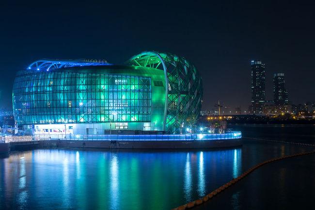 Futuristic Architecture Banpo Hangang Park Built Structure Colorful Hall Of Fame Illuminated Island, Landmark City Modern Architecture Night River View Seoul Korea Steel Tower  Urban Landscape