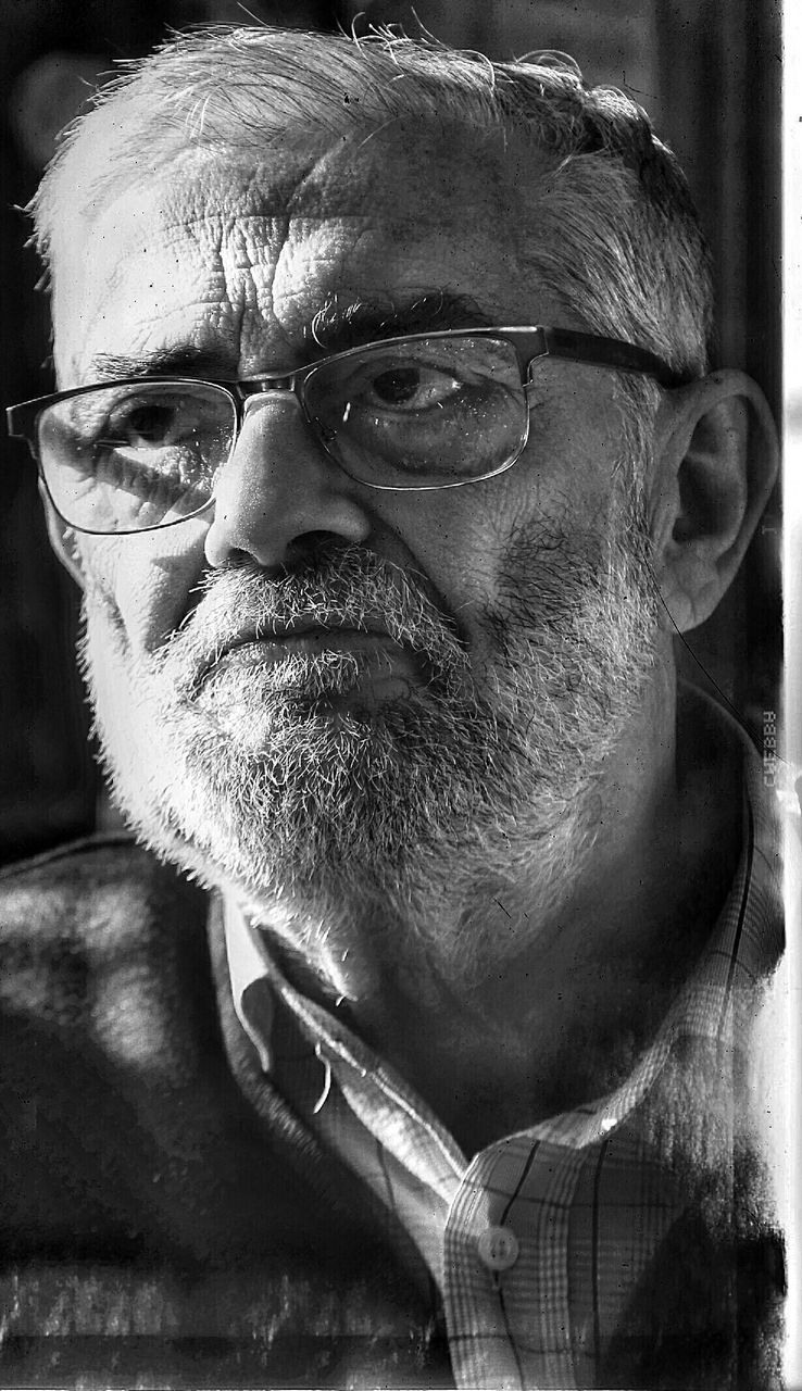 senior adult, senior men, eyeglasses, real people, beard, portrait, one senior man only, one person, looking at camera, front view, mustache, human face, lifestyles, headshot, close-up, glasses, outdoors, men, day, only men, adult, adults only, people
