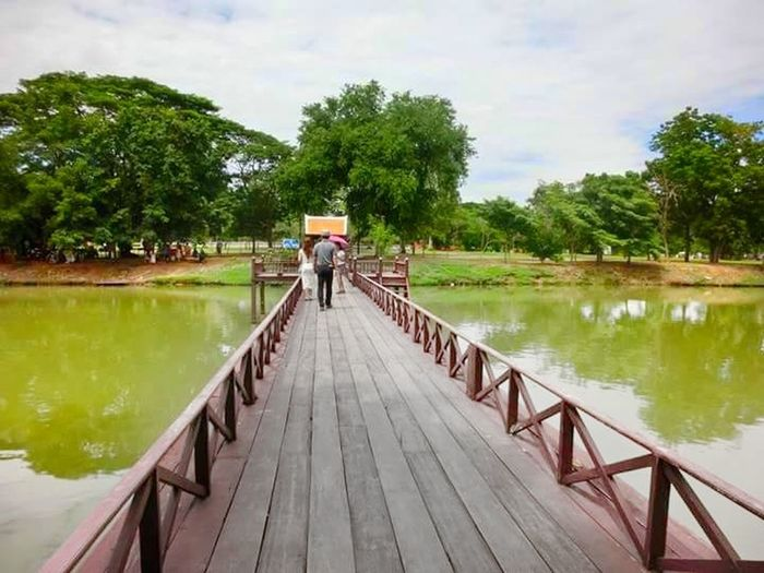 The Bridge. Thailand🇹🇭 Thailand Love Ayutthaya Thailand Ayutthaya Historical Park, Bangkok Water Adults Only Full Length Tree Two People Cloud - Sky Adult People Only Men Lake Outdoors Reflection Nature Day Sky Men Rear View Wood - Material Footbridge Togetherness