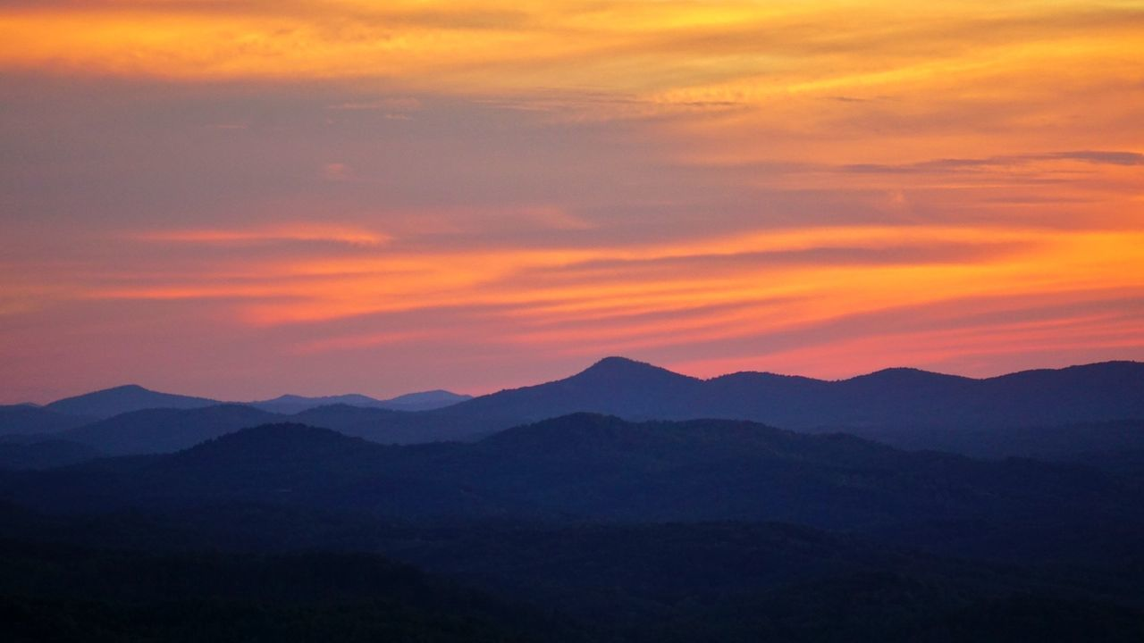 Sunset Mountain Scenics Tranquil Scene Tranquility Beauty In Nature Silhouette Sky Dark Nature Mountain Range Majestic Cloud Orange Color Physical Geography Dramatic Sky Vibrant Color Atmosphere Geology Outdoors Mountains Mountainsarecalling