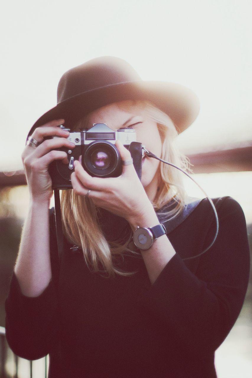 Woman Photographing Through Retro Camera