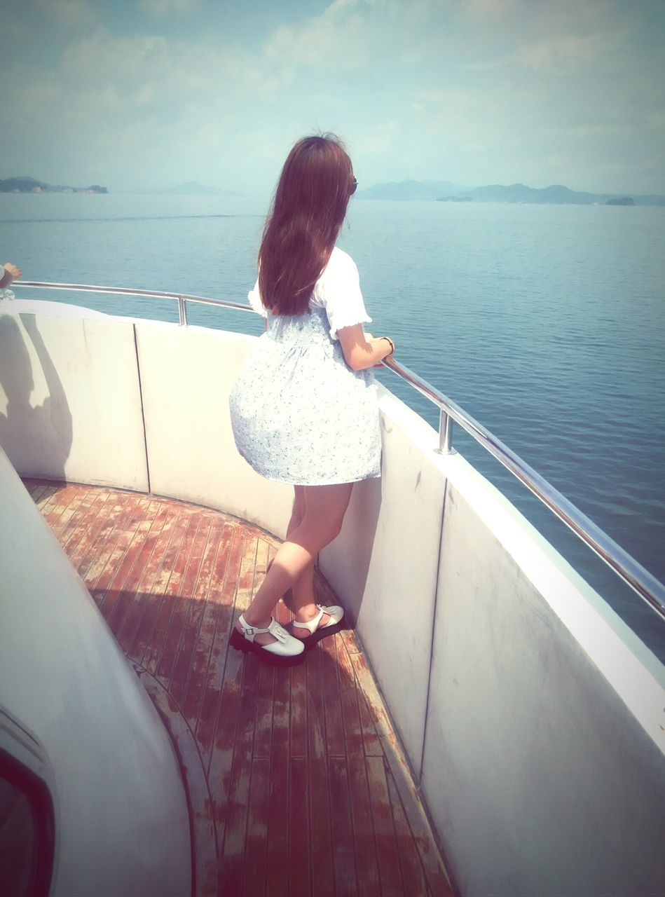 sea, transportation, mode of transport, water, rear view, one person, nautical vessel, horizon over water, real people, standing, scenics, nature, day, leisure activity, outdoors, journey, vacations, car, travel, beauty in nature, sky, lifestyles, sailing, women, boat deck, young adult, people