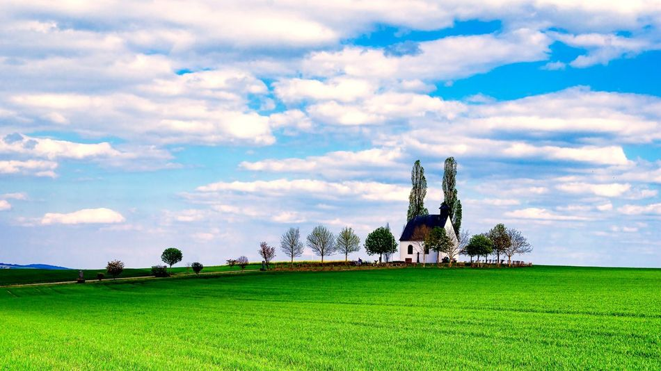 Architecture Beauty In Nature Built Structure Cloud - Sky Day Field Grass Green Color Growth Landscape Nature No People Outdoors Scenics Sky Tranquil Scene Tranquility Travel Destinations Tree The Secret Spaces