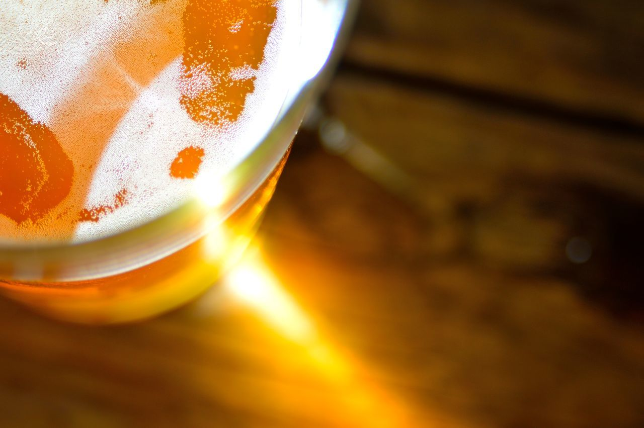 I call this one Solar Flare. Seems my drink was feeling stellar. Close-up Creative Light And Shadow Detail Full Frame Glowing Illuminated Macro No People Orange Color Pub Rich Colors Selective Focus Still Life Stock Photo Color Of Life