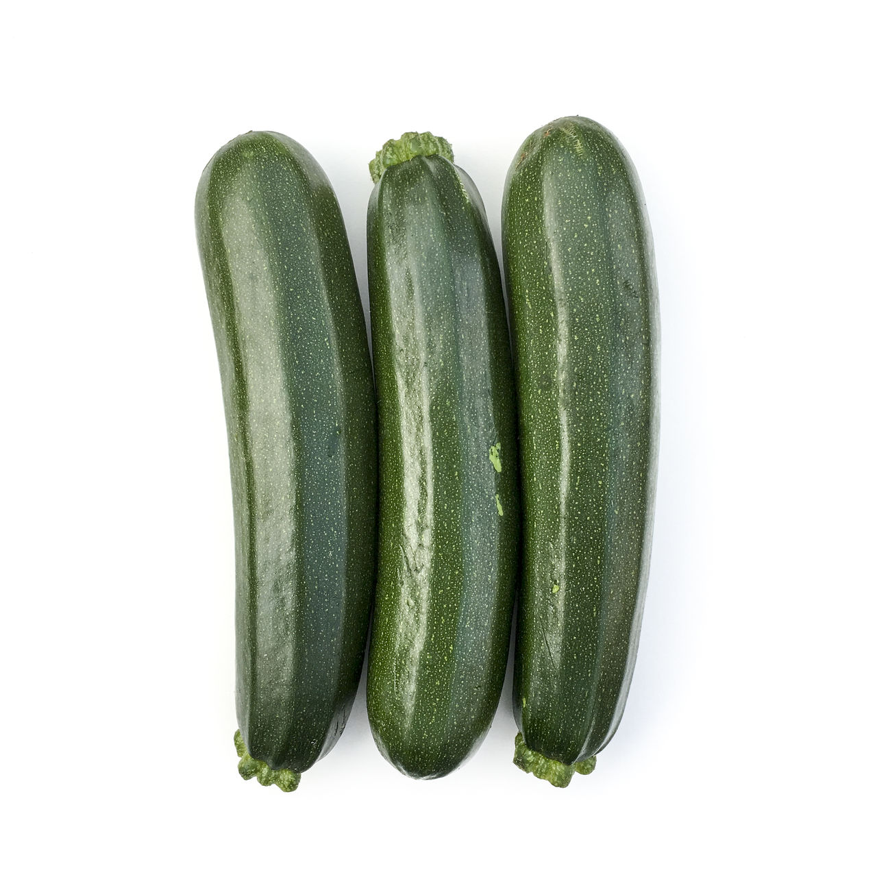 Courgettes Close-up Copy Space Courgette Courgettes Cut Out Food Food And Drink Freshness Green Green Color Group Of Objects Healthy Eating High Angle View Marrow Raw Food Still Life Studio Shot Vegetable White Background