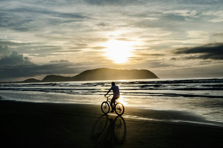 Beach Photography Biker Sunshine ☀ Horizon Over Land Destiny Bicycle Cycling Sunset Silhouette Beach Sea Water Full Length Cloud - Sky Outdoors One Person Scenics People Adult Nature Mountain Healthy Lifestyle Sky One Man Only Human Body Part