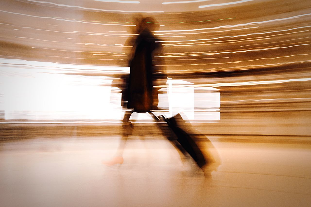 Traveling Home For The Holidays I'll get you my pretty... Blurred Motion Motion Indoors  Adults Only One Person Speed Full Length One Woman Only Adult Architecture People Day Wizard Of Oz Wicked Witch Of The West Airport Stanstead Airport Shutter Speed Red Shoes 😚