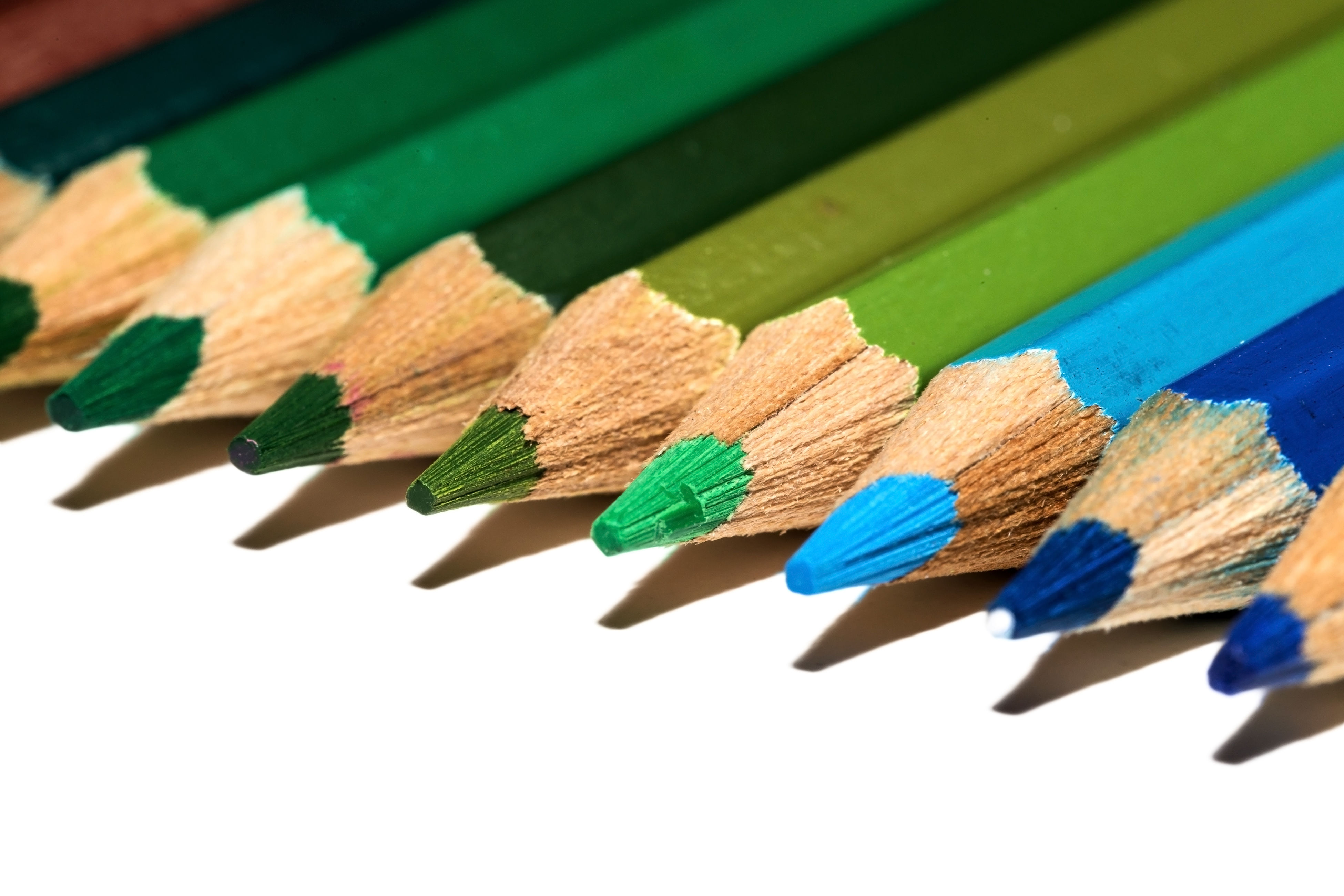 pencil, close-up, studio shot, multi colored, still life, colored pencil, variation, paper, large group of objects, in a row, wood - material, white background, colorful, arrangement, education, blue, ideas, choice, group of objects, no people, medium group of objects, abundance, sharp, side by side, wooden, green color, detail, clothespin