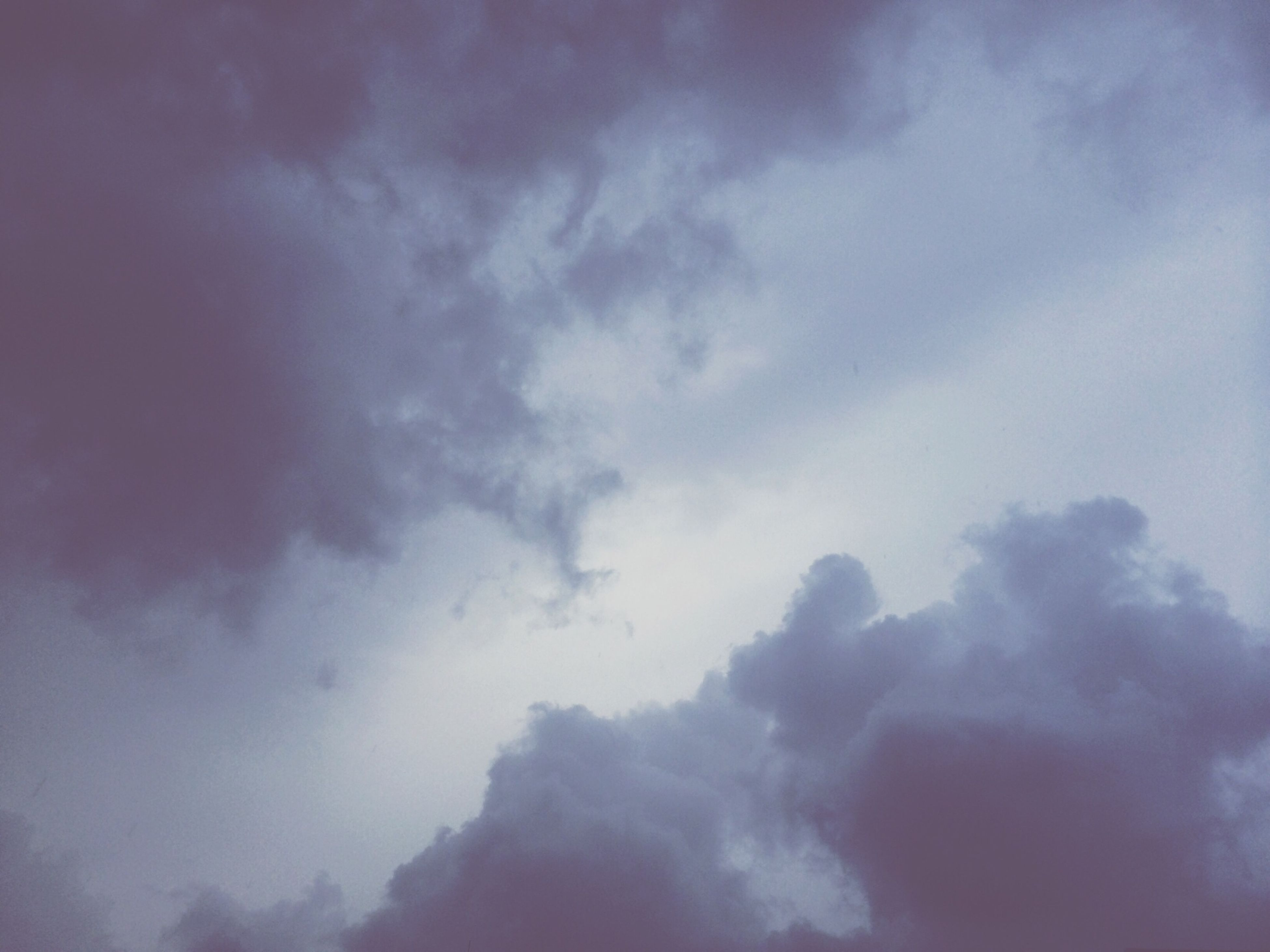 sky, cloud - sky, low angle view, cloudy, beauty in nature, tranquility, scenics, nature, tranquil scene, cloud, weather, cloudscape, idyllic, sky only, outdoors, no people, backgrounds, day, overcast, blue