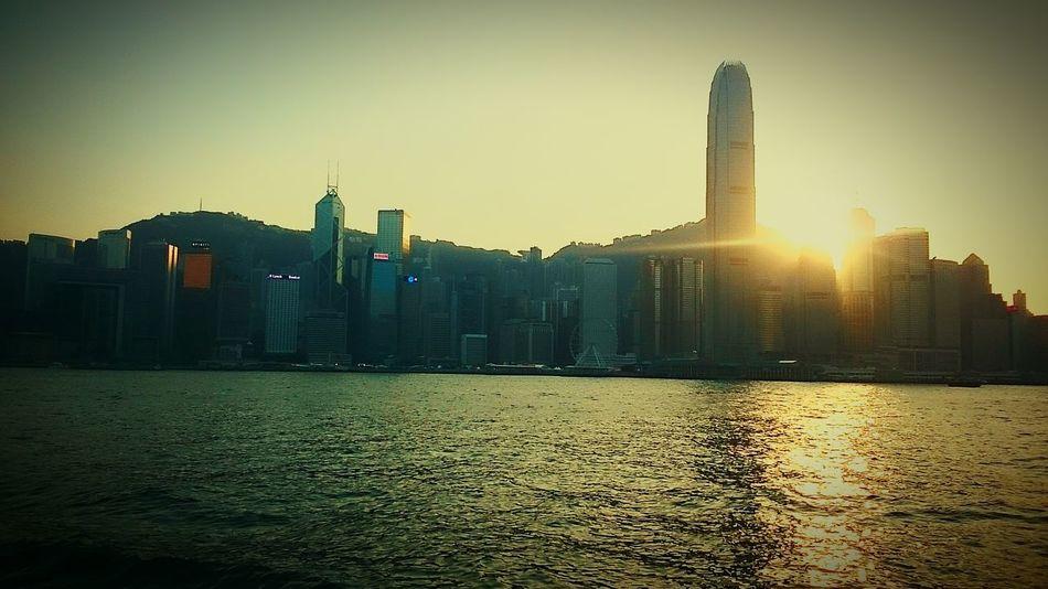 Sunset tall buildings sea Taking Photos