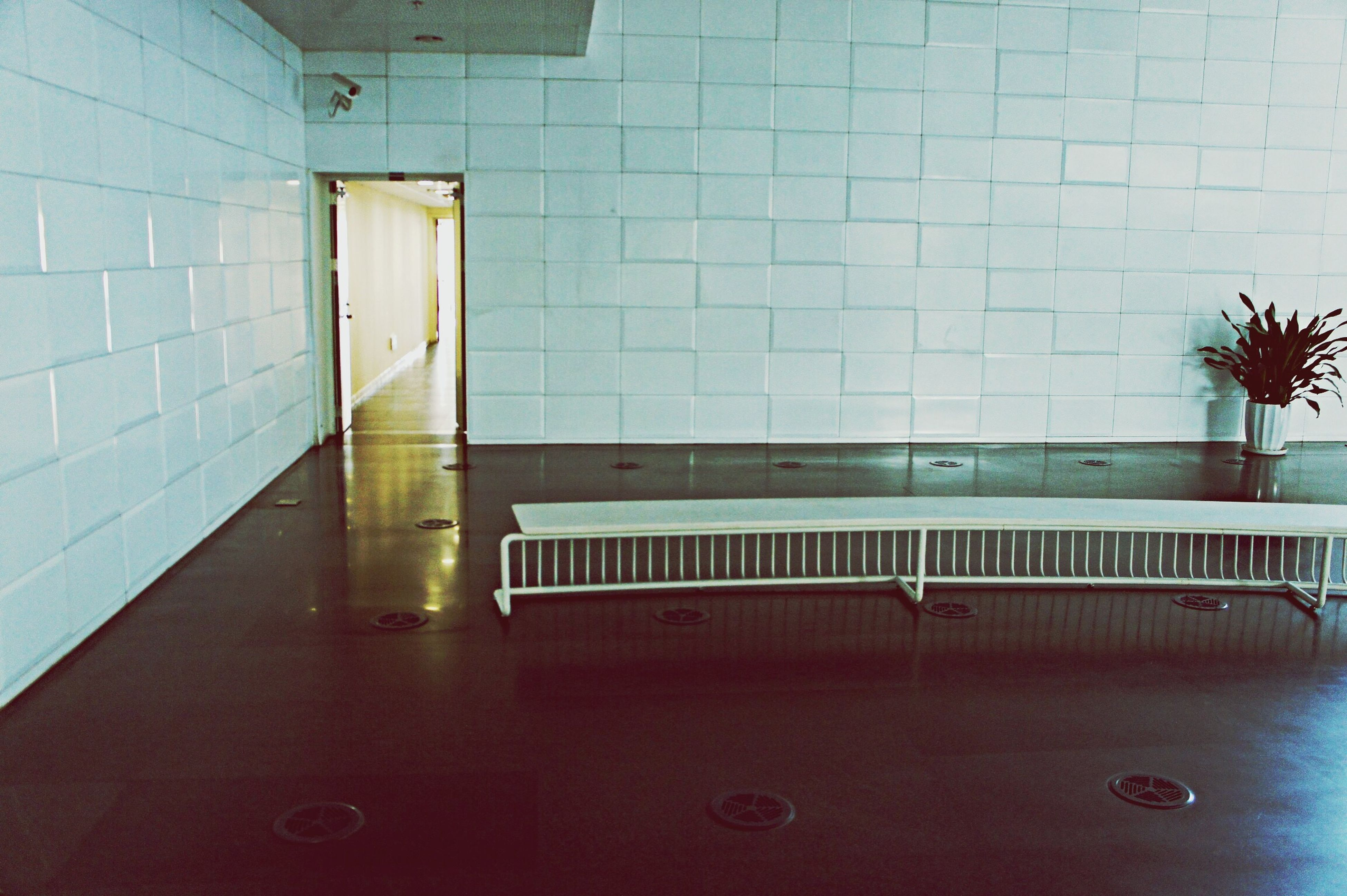 indoors, architecture, built structure, empty, wall - building feature, window, door, reflection, wall, tile, tiled floor, flooring, absence, no people, interior, modern, glass - material, building, illuminated, ceiling