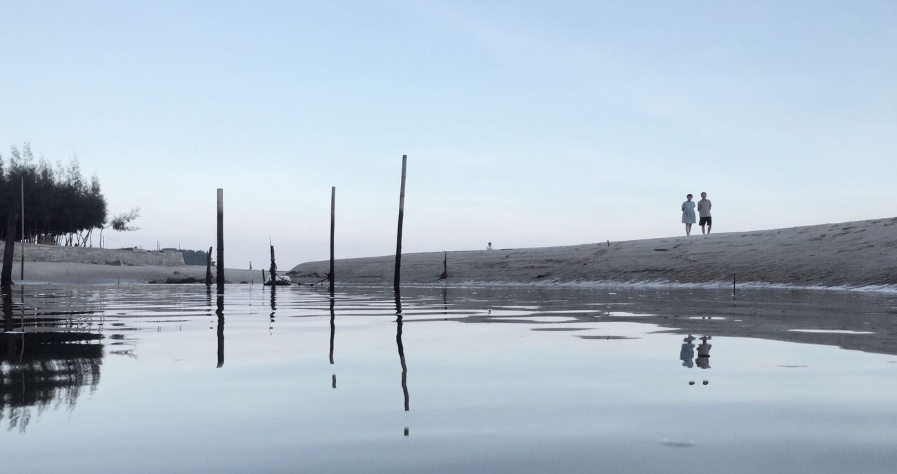 DONGSHAN ISLAND- 旅志 Reflection Water Tranquility Tranquil Scene Clear Sky Silhouette Scenics Standing Calm Nature Beauty In Nature Waterfront Pole Wooden Post Day Sea Outdoors Sky Non-urban Scene Vacations