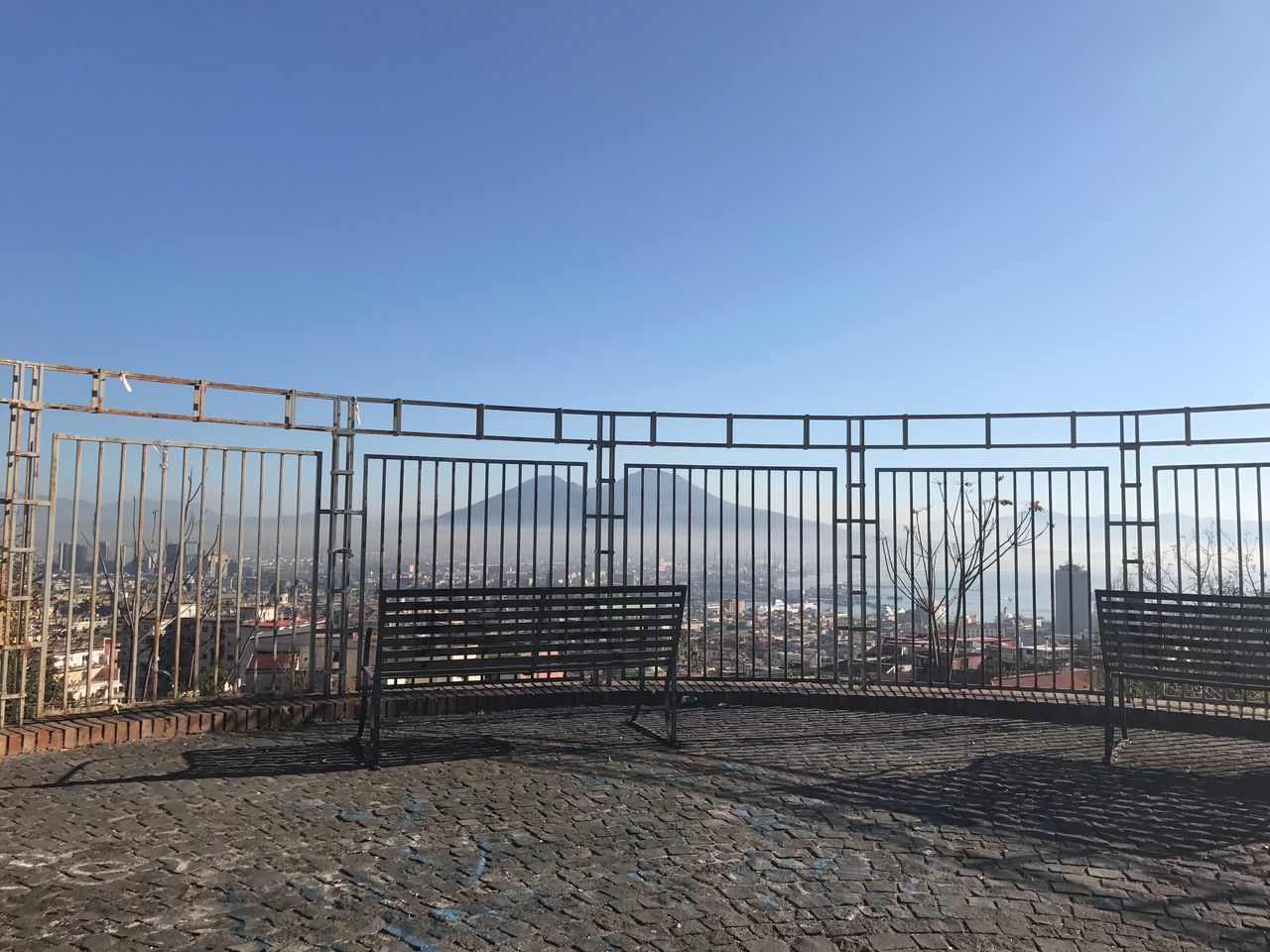 railing, architecture, clear sky, no people, outdoors, built structure, day, city, sky