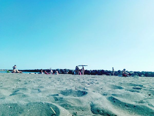 Beach Sand Sky Sunny Sea Large Group Of People Outdoors Day Clear Sky Blue People Adult Nature Adults Only Men Vacations Water Real People Only Men