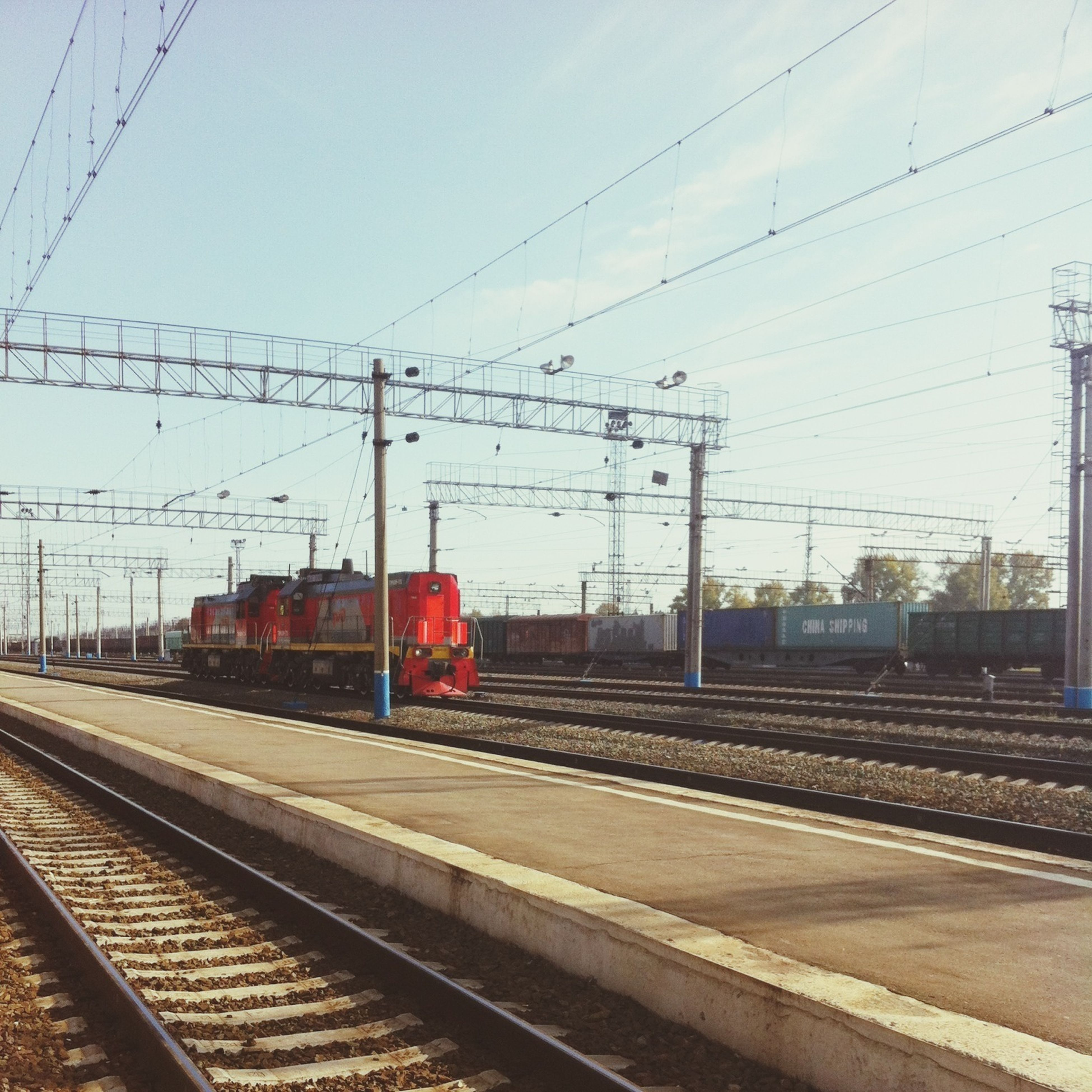 railroad track, rail transportation, transportation, public transportation, power line, railroad station platform, railroad station, electricity pylon, train - vehicle, cable, power supply, railway track, electricity, sky, train, passenger train, travel, connection, power cable, mode of transport