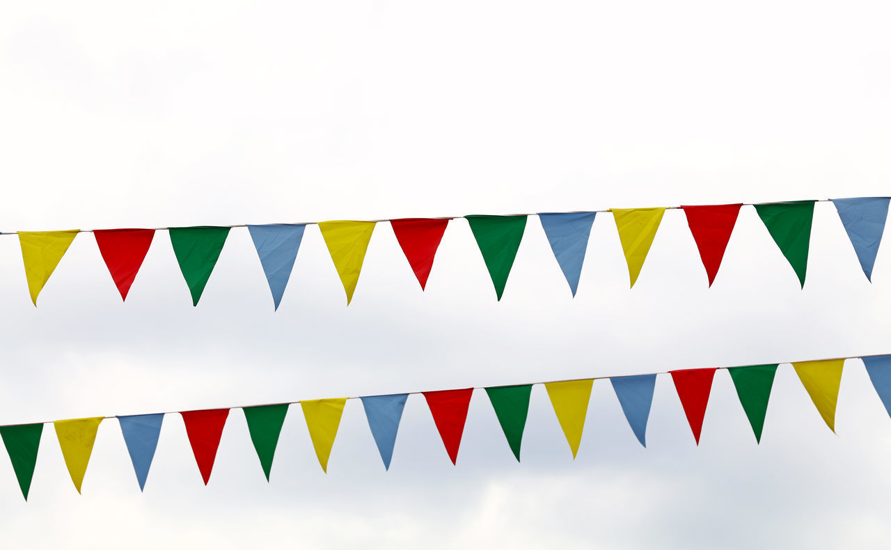 Low Angle View Of Bunting Against Sky