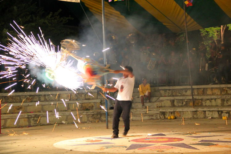 Enjoyment Firework - Man Made Object Illuminated Looking Motion Night Person Playing Young Adult