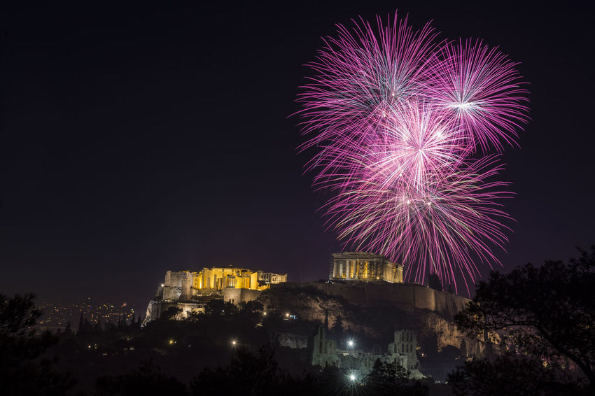 Celebration day in Athens Bright Celebration Dark Event Fireworks Parthenon Acropolis Anniversary Backgrounds Cheerful Cityscape Display Excitement Exploding Illuminated Landmark New Years Eve Night Party Performance Purple Sky Sparks Travel Destinations Vibrant