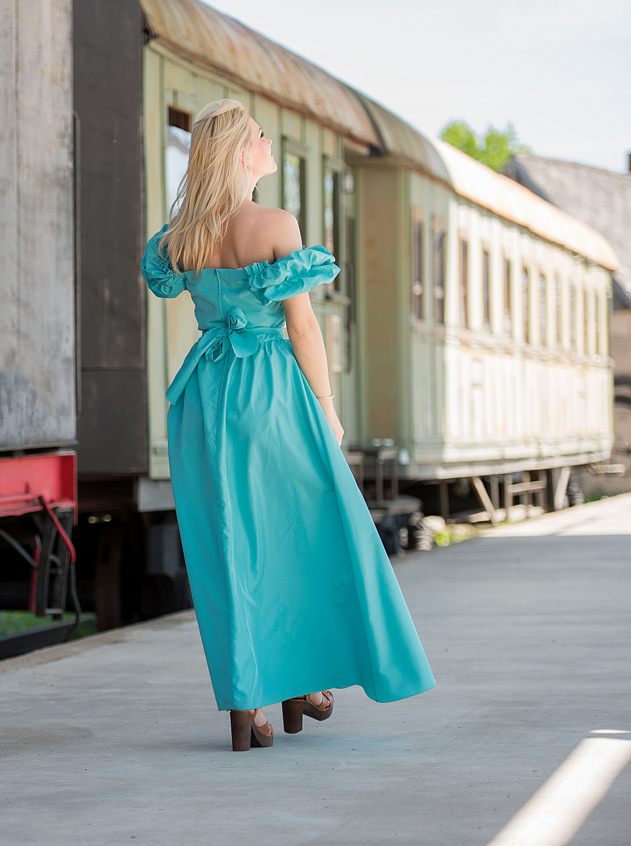 beautiful woman on the platform Architecture Beautiful Woman Blond Hair Blue Built Structure Day Full Length Green Dress Leisure Activity Lifestyles Model One Person Outdoors People Platform Real People Romance Sexygirl Sexywoman Standing Train Station Transportation Woman Back Young Adult Young Women Live For The Story