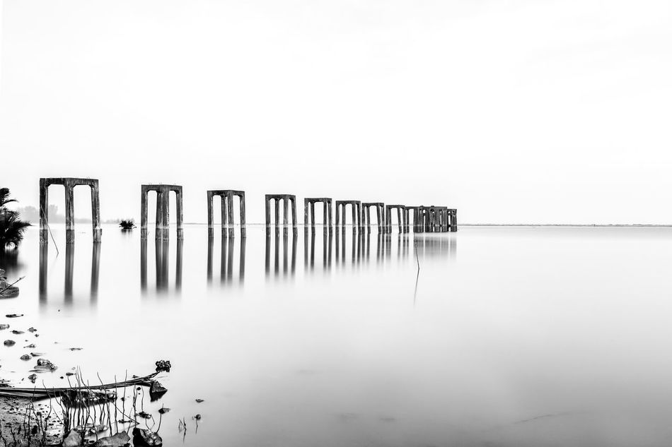 Abandoned ore bridge Architecture Built Structure Day Mineral No People Outdoors Reflection Sea Tranquility Vintage Water