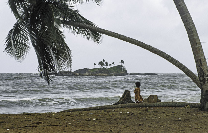 Alone Beach Beauty In Nature Choppy Waters Day Full Length Horizon Over Water Island Men Nature One Person Outdoors Palm Tree People Real People Sand Scenics Sea Shore Sky Sri Lanka Unrecognisable Person Water Young Girl