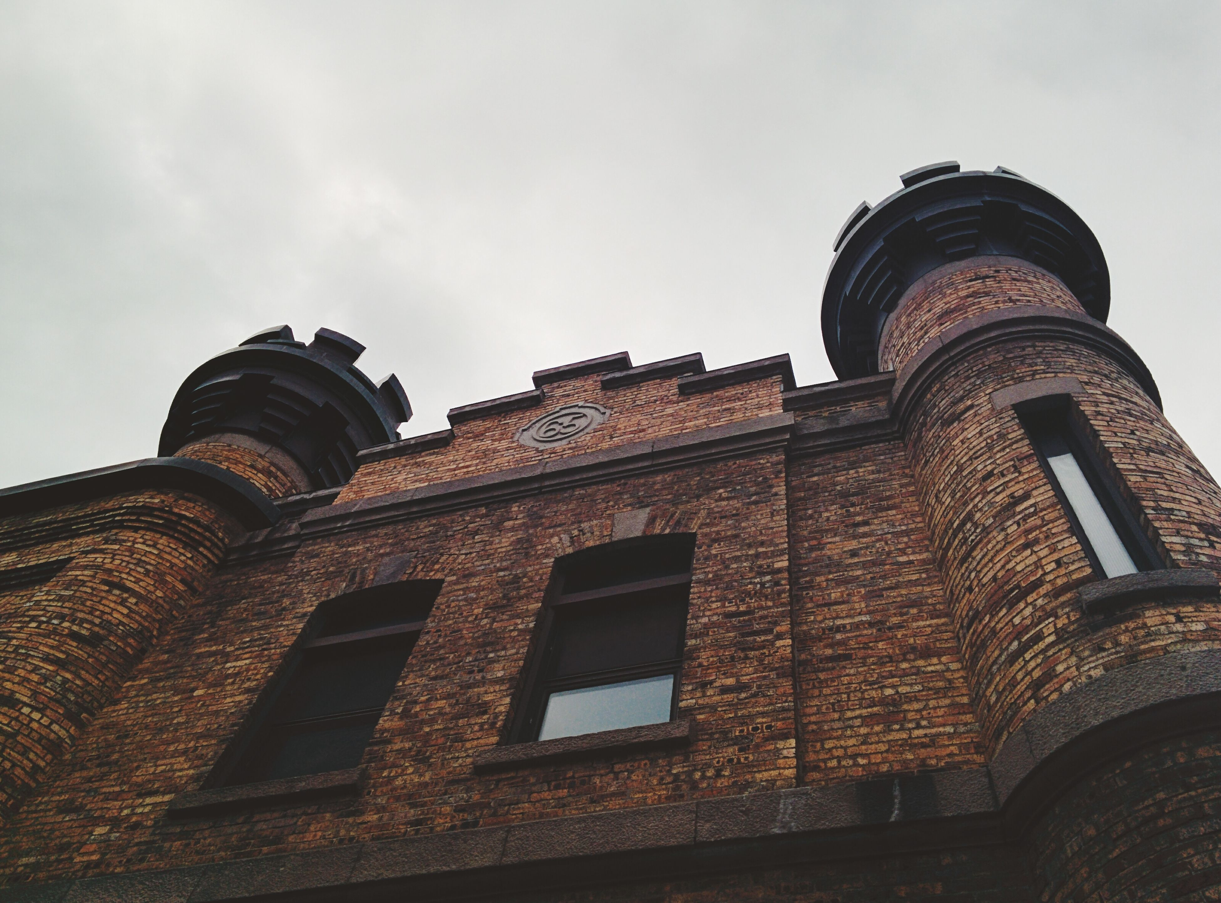 architecture, building exterior, built structure, low angle view, sky, tower, window, history, old, high section, cloud - sky, day, outdoors, no people, exterior, arch, cloud, brick wall, building, facade